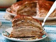 Рецепта Палачинкова торта с плънка от нишестен яйчен крем и украса от какао